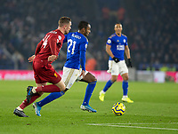 26th December 2019; King Power Stadium, Leicester, Midlands, England; English Premier League Football, Leicester City versus Liverpool; Ricardo Pereira of Leicester City with the ball at his feet gets away from Jordan Henderson of Liverpool  - Strictly Editorial Use Only. No use with unauthorized audio, video, data, fixture lists, club/league logos or 'live' services. Online in-match use limited to 120 images, no video emulation. No use in betting, games or single club/league/player publications