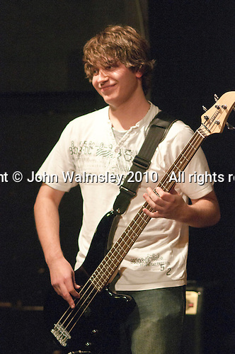 "Bass player with ""Jay's Band"" featuring Jay Won on keyboard & vocals and Grace Churchley on vocals. Students on the 2yrs National Diploma in Music course put on an evening of bands at the Grey Horse pub, Kingston upon Thames.  They would have organised everything themselves: marketing, DJ-ing, production and performing.  This band, ""Jays Band""."