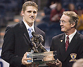 Matt Carle with the Hobey Baker - Hobey Hat Trick Ceremony - Awarding of the Hobey Baker trophy on Friday, April 7, 2006, on the ice at the Bradley Center in Milwaukee, Wisconsin.