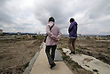 March 11, 2016, Tokyo, Japan - Former residents walk on the area destroyed by the tsunami at Namie in Fukushima prefecture near the crippled TEPCO's nuclear plant on Friday, March 11, 2016 on the fifth anniversary of the Great East Japan Earthquake and Tsunami.  (Photo by Yoshio Tsunoda/AFLO)