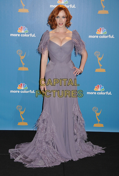 CHRISTINA HENDRICKS.62nd Annual Primetime Emmy Awards held at NOKIA Theatre Los Angeles, California, USA. .29th August 2010.full length purple dress maxi feathers hand on hip cleavage .CAP/ADM/BP.©Byron Purvis/AdMedia/Capital Pictures.