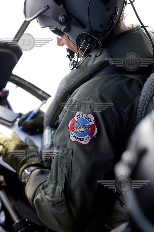 Pilot Bjørn Bottolfsen in the cockpit. Crew from Norwegian Air Force 330 squadron, flying Westland Sea King helicopter. The core mission of the squadron is SAR (search and rescue), but they also fly HEMS (Helicopter Emergency Medical Service), complementing the civilian air ambulance service.<br />