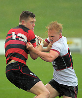 Jack Heighton (right) ties to bring down Dallas McLeod during the Jock Hobbs Memorial Under-19 Tournament rugby match between North Harbour and Canterbury at Owen Delany Park in Taupo, New Zealand on Saturday, 16 September 2012. Photo: Dave Lintott / lintottphoto.co.nz