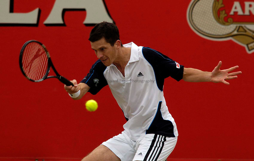 Photo. Jed Wee..Stella Artois Championships. .10/06/2005..Britain's Tim Henman in action against Thomas Johansson.