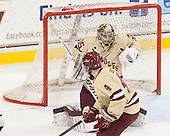 Teddy Doherty (BC - 4), Parker Milner (BC - 35) - The Boston College Eagles defeated the visiting University of Vermont Catamounts to sweep their quarterfinal matchup on Saturday, March 16, 2013, at Kelley Rink in Conte Forum in Chestnut Hill, Massachusetts.