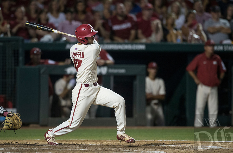 NWA Democrat-Gazette/BEN GOFF @NWABENGOFF<br /> Luke Bonfield, Arkansas designated hitter, hits a RBI single in the 8th inning against South Carolina Saturday, June 9, 2018, during game one of the NCAA Super Regional at Baum Stadium in Fayetteville.