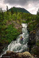Rafters battle the rapids on the Kenai Peninsula's Six Mile Creek, one of Alaska's premiere whitewater rafting adventures.