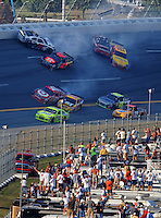 Oct 5, 2008; Talladega, AL, USA; NASCAR Sprint Cup Series drivers Travis Kvapil (28), Juan Pablo Montoya (42), Carl Edwards (99), Kevin Harvick (29), Reed Sorenson (41), Dave Blaney (22) crash as Paul Menard (15), Jimmie Johnson (48) and Kyle Busch (18) go low to avoid during the Amp Energy 500 at the Talladega Superspeedway. Mandatory Credit: Mark J. Rebilas-