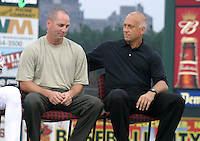 August 29, 2003:  Cal Ripken Jr and his brother Billy Ripken sit as Cal is inducted into the Rochester Red Wings Hall of Fame before an International League game at Frontier Field in Rochester, NY.  Photo by:  Mike Janes/Four Seam Images