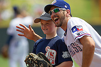 Round Rock Express third baseman Adam Rosales #9 poses with a fan prior to the Pacific Coast League baseball game against the Memphis Redbirds on April 27, 2014 at the Dell Diamond in Round Rock, Texas. The Express defeated the Redbirds 6-2. (Andrew Woolley/Four Seam Images)