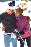 Friends age 55 embracing on afternoon cross country ski outing. Crosby Park Nature Reserve St Paul  Minnesota USA