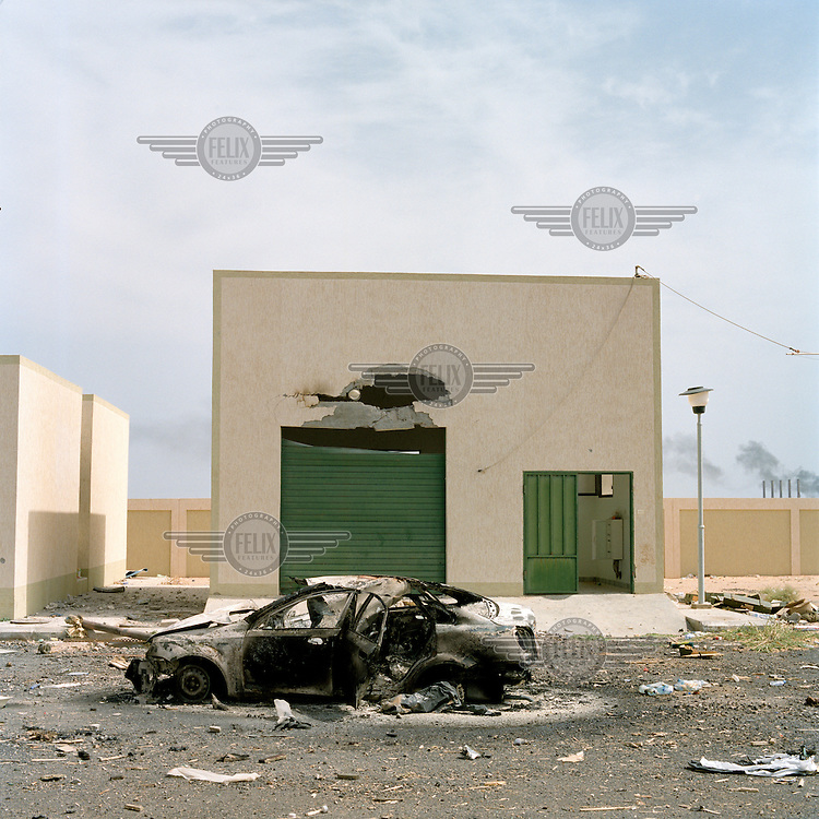 The aftermath of a NATO airstrike on the outskirts of the town of Ras Lanuf. A garage and a car lie destroyed. On 17 February 2011 Libya saw the beginnings of a revolution against the 41 year regime of Col Muammar Gaddafi.