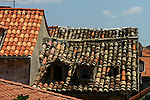 Dubrovnik roofs after the Croatian civil war -- the old mixed with the new.