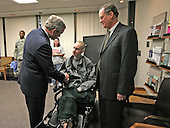 Washington, DC - December 20, 2007 -- United States President George W. Bush presents the Purple Heart to United States Army Specialist John C. Hoxie of Philippi, West Virginia, during a visit Thursday, December 20, 2007, to Walter Reed Army Medical Center in Washington, D.C., where the soldier is recovering from injuries suffered in Operation Iraqi Freedom.  Looking on is the soldier's father, David Hoxie. .Credit: Joyce N Boghosian - White House via CNP
