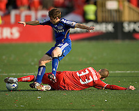 26 April 2009: Kansas City Wizards midfielder/forward Michael Kraus #30 gets slide tackled by Toronto FC midfielder Carl Robinson #33 during an MLS game between Kansas City Wizards and Toronto FC.Toronto FC won 1-0. .