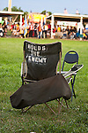 A chair saves a spot for the owner in the dance arena before the Grand Entry dance.