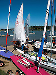 Sailing dinghies being launched, River Deben, Woodbridge, Suffolk, England, UK