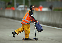 A safety marshall crosses the track after the second Toyota Racing Series race. The Mad Butcher 200 - New Zealand Grand Prix at Manfeild Autocourse, Feilding. Sunday 14 February 2010. Photo: Dave Lintott / lintottphoto.co.nz