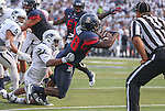 Arizona's Nick Wilson (28) scores against Nevada's Kendall Johnson (26) during the first half of an NCAA college football game in Reno, Nev. on Saturday, Sept. 12, 2015. (AP Photo/Cathleen Allison)