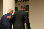 United States President Barack Obama with U.S. Vice President Joseph Biden by his side, returns to the Oval Office after delivering a statement on today's Affordable Care Act ruling from the U.S. Supreme Court in the Rose Garden of the White House on June 25, 2015.<br /> Credit: Dennis Brack / Pool via CNP