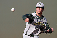 Jake Reed #5 of the Oregon Ducks warms up before pitching against the UCLA Bruins at Jackie Robinson Stadium on April 6, 2012 in Los Angeles,California. Oregon defeated UCLA 8-3.(Larry Goren/Four Seam Images)