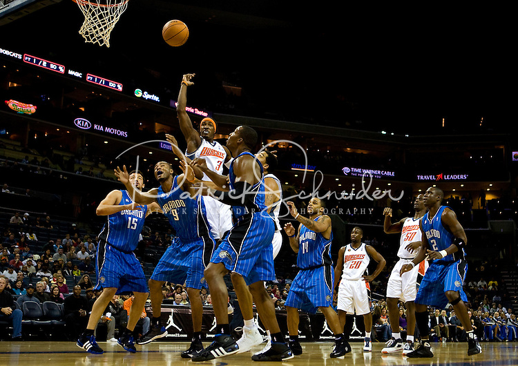 Charlotte Bobcats forward Gerald Wallace (3) shoots over the Orlando Magic during an NBA basketball game  at Time Warner Cable Arena in Charlotte, NC.