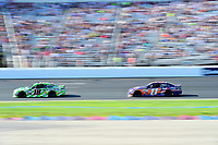 July 16, 2017 - Loudon, New Hampshire, U.S. - Denny Hamlin, Monster Energy NASCAR Cup Series driver of the FedEx Office Toyota (11), chases Kyle Busch,  driver of the Interstate Batteries Toyota (18), during the NASCAR Monster Energy Overton's 301 race held at the New Hampshire Motor Speedway in Loudon, New Hampshire. Larson placed first in the qualifier. Eric Canha/CSM