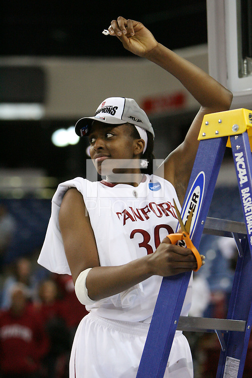 SACRAMENTO, CA - MARCH 29: Nnemkadi Ogwumike cuts the net after Stanford's 55-53 win over Xavier in the NCAA Women's Basketball Championship Elite Eight on March 29, 2010 at Arco Arena in Sacramento, California.