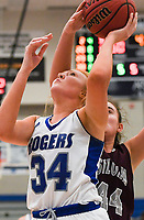NWA Democrat-Gazette/CHARLIE KAIJO Rogers High School forward Ally Figenskau (34) takes a shot as Siloam Springs High School center Mia Hevener (44) blocks, during the Great 8 Tournament, Thursday, November 29, 2018 at King Arena at Rogers High School in Rogers.