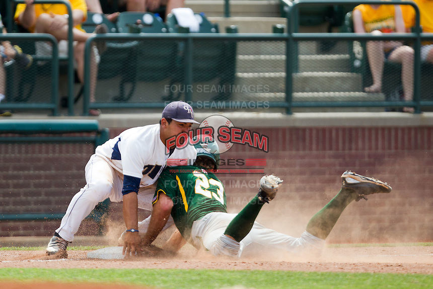 Oral Roberts Golden Eagles third baseman Jose Trevino #5 blocks a Baylor baserunner during the NCAA Regional baseball game against Baylor University on June 3, 2012 at Baylor Ball Park in Waco, Texas. Baylor defeated Oral Roberts 5-2. (Andrew Woolley/Four Seam Images).
