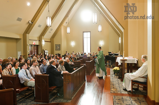 Sept. 19, 2013; Rev. Paul Kollman, C.S.C., director of the Center for Social Concerns, gives the homily at the annual Mass in honor of the Andrews and McMeel families who support the Center's Summer Service Learning Project.<br /> <br /> Photo by Matt Cashore/University of Notre Dame