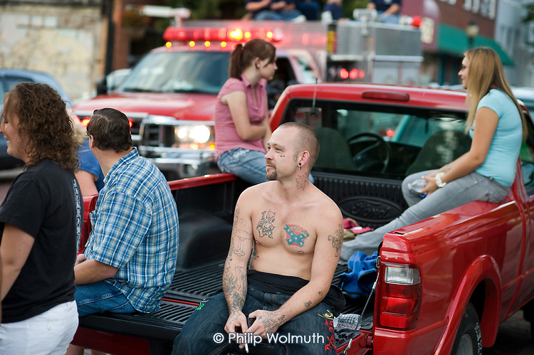 Residents of Hinton, West Virginia, an impoverished town affected by the decline in the local coal mining industry, watch a parade by volunteer firefighters.