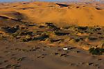 Namibia;  Namib Desert, Skeleton Coast,  4x4 vehicle on dunes near Walvis Bay, aerial view, image taken from powered paraglider