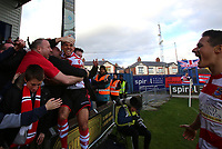 Dan Bennett of Kingstonian celebrates with fans after scoring the third during Macclesfield Town vs Kingstonian, Emirates FA Cup Football at the Moss Rose Stadium on 10th November 2019
