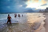 BRAZIL, Rio de Janiero, people play in the water at Ipanema Beach