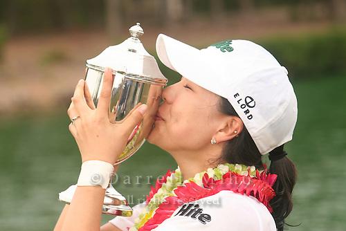 February 18, 2006; Kahuku, HI - Joo Mi Kim kisses her trophy during the awards ceremony after winning the LPGA SBS Open at Turtle Bay Resort...Mandatory photo credit: Darrell Miho.© Darrell Miho