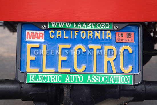 A license plate of the first electric vehicle owned by an Electric Auto Association member. The car is a 1904 'Merry' Oldsmobile replica, built by Bill Palmer and son in 1967 and now owned by Pat Parmelee. Electric Vehicle Rally in Palo Alto, hosted by the Silicon Valley Chapter of the Electric Auto Association. Palo Alto, California, USA