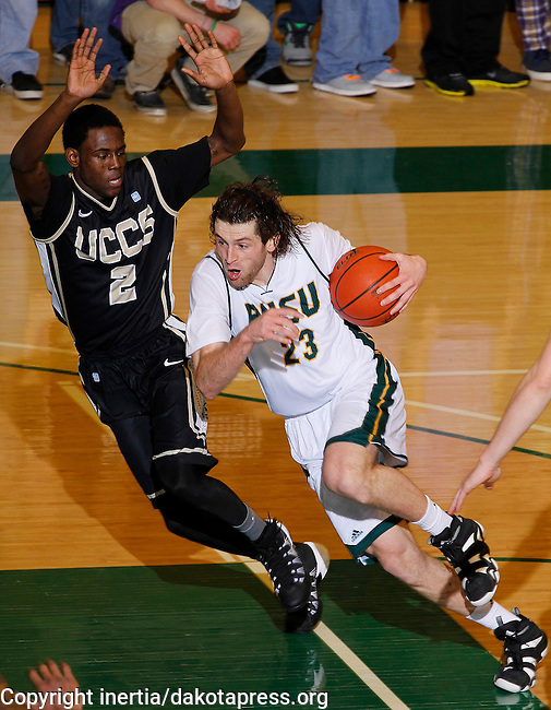 SPEARFISH, SD - FEBRUARY 22, 2014:  Tommy Earl #23 of Black Hills State drives on TreShawn Wilford #2 of UC-Colorado Springs during their Rocky Mountain Athletic Conference game Saturday evening at the Donald E. Young Center in Spearfish, S.D.  (Photo by Dick Carlson/Inertia)