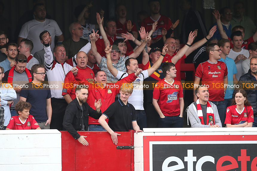 Wrexham fans cheer on their team during Dagenham & Redbridge vs Wrexham, Vanarama National League Football at the Chigwell Construction Stadium on 13th October 2018