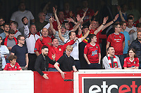 Wrexham fans cheer on their team during Dagenham & Redbridge vs Wrexham, Vanarama National League Football at the Chigwell Construction Stadium on 13th October 2018