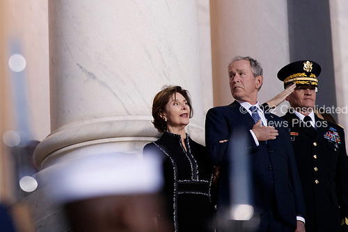 Former US President George W Bush and former First Lady Laura Bush look on as a joint service members of a military casket team carry the casket of former President George H. W. Bush into the US Capitol, where he will lie in state until Wednesday morning in Washington, DC, USA, 03 December 2018. Bush will lie in state in the Capitol Rotunda before his state funeral at the Washington National Cathedral 05 December. George H.W. Bush, the 41st President of the United States (1989-1993), died at the age of 94 on 30 November 2018 at his home in Texas.