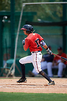 GCL Braves shortstop Livan Soto (13) hits an infield single during a game against the GCL Pirates on July 27, 2017 at ESPN Wide World of Sports Complex in Kissimmee, Florida.  GCL Braves defeated the GCL Pirates 8-6.  (Mike Janes/Four Seam Images)