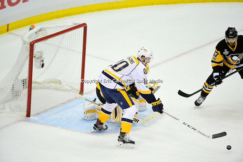 May 31, 2017: Nashville Predators center Colton Sissons (10) reaches for the rebounding puck during game two of the National Hockey League Stanley Cup Finals between the Nashville Predators  and the Pittsburgh Penguins, held at PPG Paints Arena, in Pittsburgh, PA. The Penguins defeat the Predators 4-1 and lead the series 2-0. Eric Canha/CSM