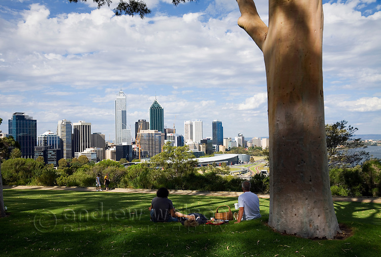 Picnic under the shade of a tree in Kings Park, overlooking Perth city.  Perth, Western Australia, AUSTRALIA.