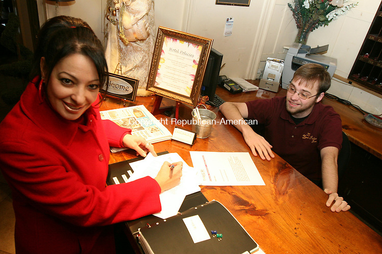 BARKHAMSTED, CT - 4 April, 2008 - 122608MO02 - Dale M. Foti of Tower Isle Productions fills out a release form for the Yankee Pedlar Inn Friday as front desk clerk Gary Woinn looks on. The film company hopes to return with cameras in hand. Jim Moore Republican-American.