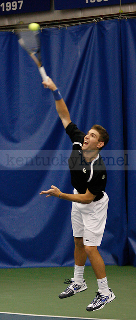 Senior Eric Quigley serves the ball against Tulsa on 1/28/12 at the Hilary J. Boone Tennis Center in Lexington, Ky. Photo by Quianna Lige | Staff