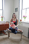 Cass Ghiorse is a dancer, model, actress, and yoga instructor who recently moved from Williamsburg to Irvington. She used to be a server at Marlowe & Sons, and now teaches in a new yoga studio in Hastings-on-Hudson. She poses for a portrait with her 4-month-old daughter Frances at home...Danny Ghitis for The New York Times