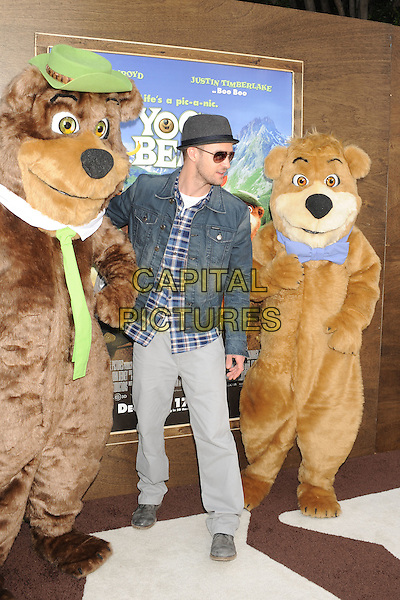 "JUSTIN TIMBERLAKE .arriving at the Los Angeles premiere of ""Yogi Bear"" in Westwood Village, California, USA, December 11th, 2010. .full length denim jacket hat plaid blue shirt trousers hat beige .CAP/ROT/TM.©TM/Roth StockCapital Pictures"