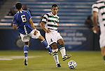 09 December 2011: UNCC's Charles Rodriguez (4) is defended by Creighton's Dion Acoff (6). The Creighton University Bluejays played the University of North Carolina Charlotte 49ers to a 0-0 overtime tie, the 49ers won the penalty shootout 4-1 to advance at Regions Park in Hoover, Alabama in an NCAA Division I Men's Soccer College Cup semifinal game.