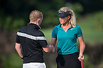 Suzann Pettersen (right) shakes hands and chats with Paul Scholes during the World Celebrity Pro-Am 2016 Mission Hills China Golf Tournament on 23 October 2016, in Haikou, Hainan province, China. Photo by Victor Fraile / Power Sport Images